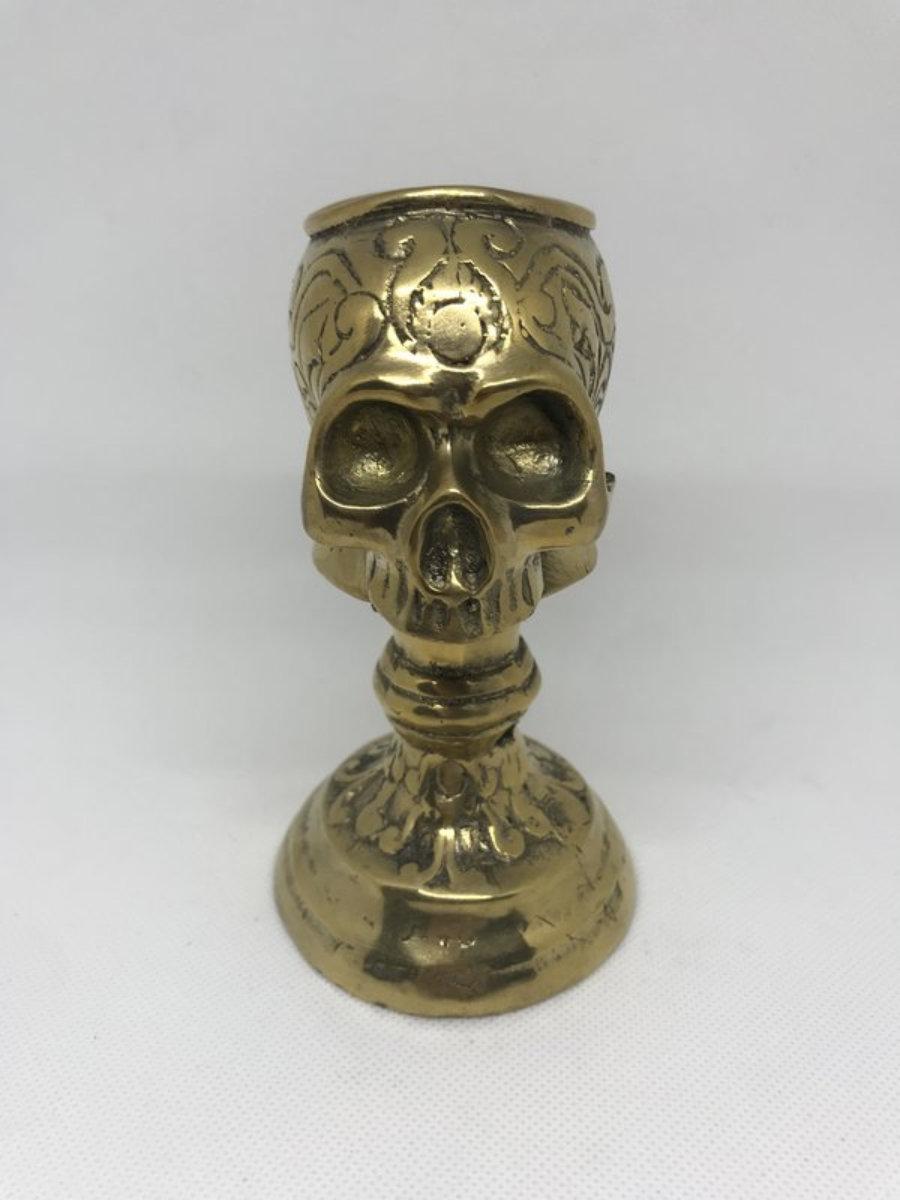 Candelabro metal calavera dorado