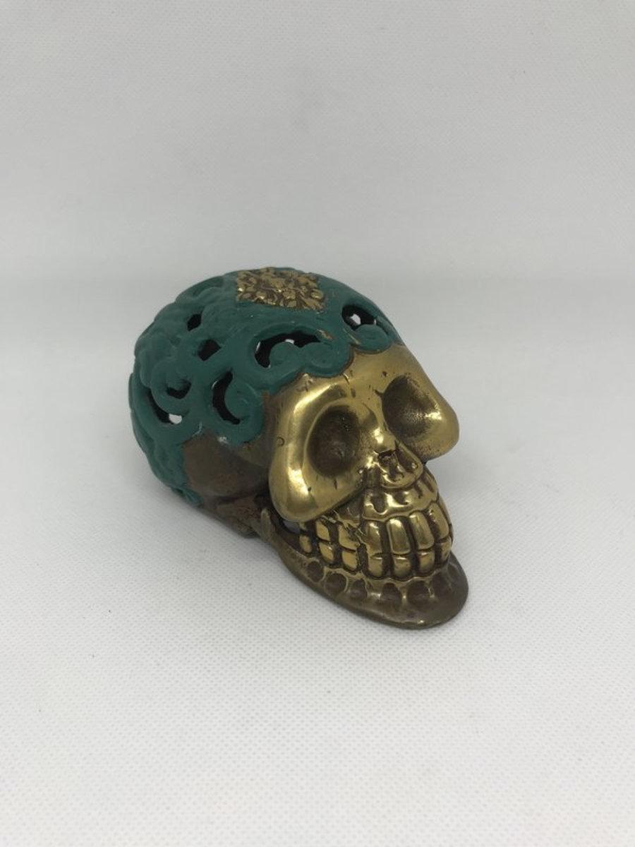 Calavera metal carving verde