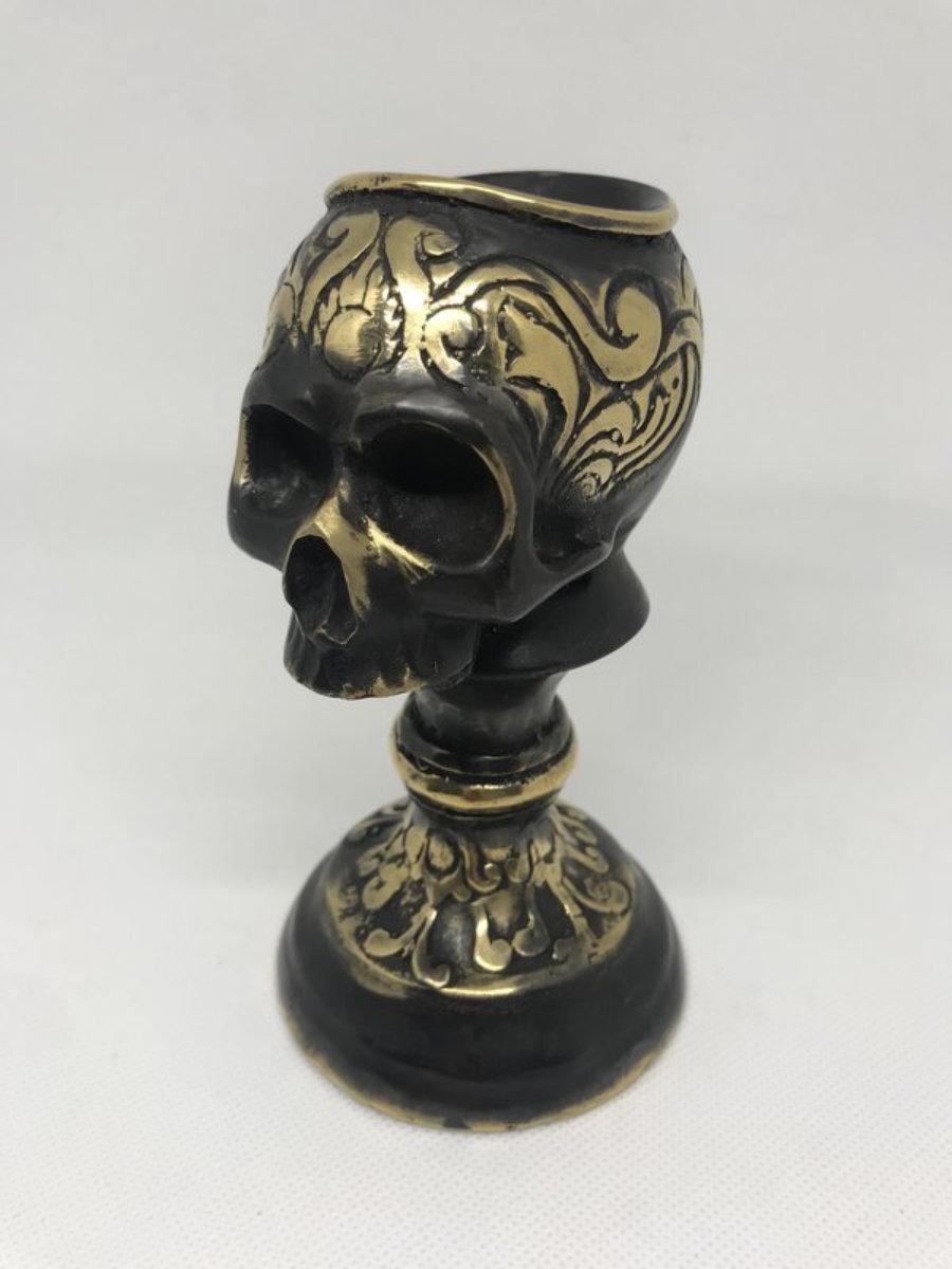Candelabro calavera metal negro/dorado